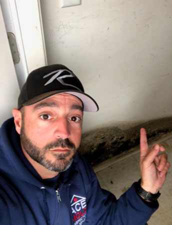 Frank pointing out mold damage